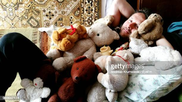 Portrait Of Man With Stuffed Toys