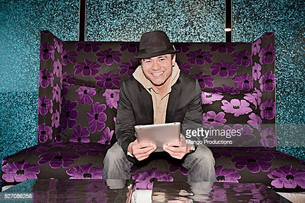 Portrait of man with tablet pc in nightclub