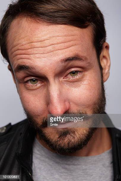 Portrait of man with teary eyes