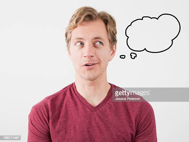 Portrait of man with thought bubble near his head