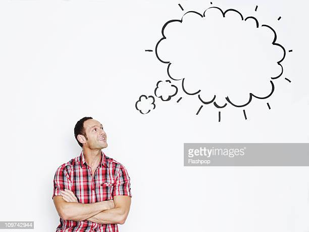 portrait of man with thought bubble - thought bubble stock pictures, royalty-free photos & images