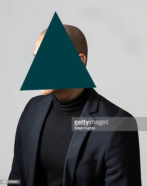 Portrait of man with triangle over his face