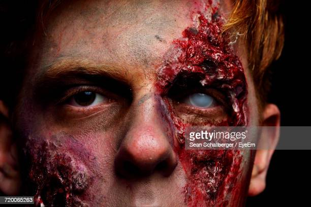 portrait of man with zombie make-up - zombie makeup stock photos and pictures