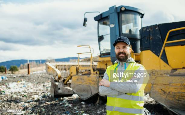 portrait of man worker on landfill, waste management and environmental concept. - 廃棄物処理 ストックフォトと画像