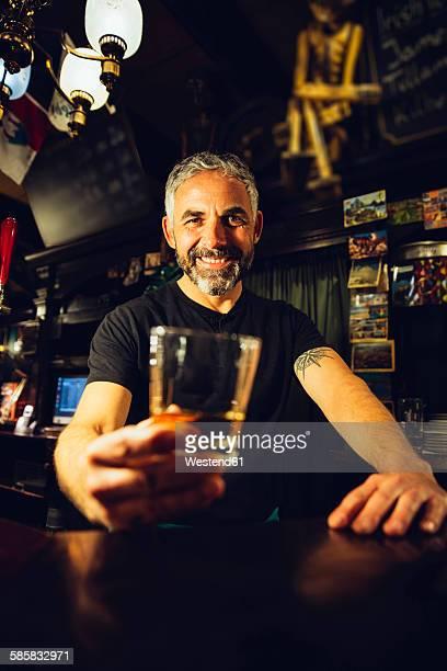 Portrait of man working in an Irish pub