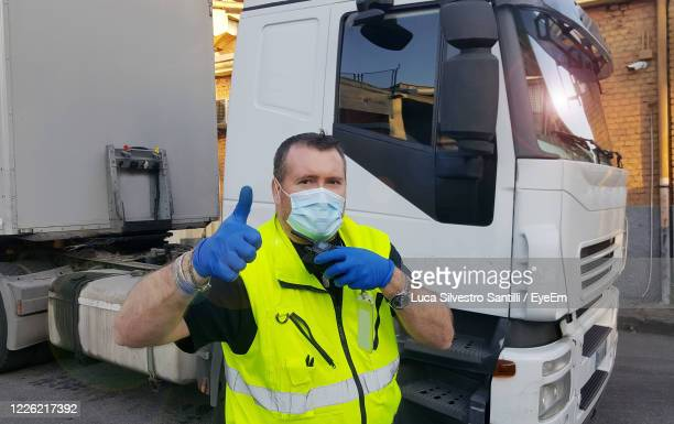 portrait of man working on bus - essential services stock pictures, royalty-free photos & images