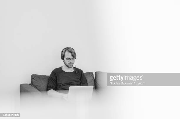 Portrait Of Man Working On Laptop