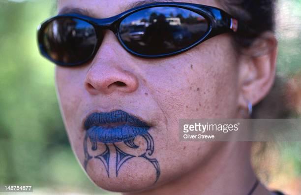 Portrait of Maori woman with moko (traditional tattoos).