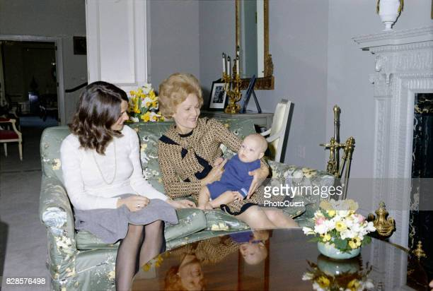 Portrait of Margaret Trudeau the wife of Canadian Prime Minister Trudeau as she smiles at her infant son future Canadian Prime Minister Justin...