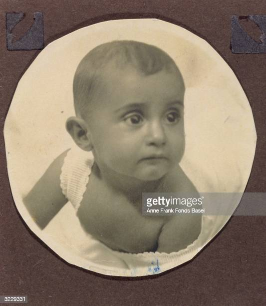 A portrait of Margot Frank older sister of Anne Frank as an infant A page from Margot Frank's photo album