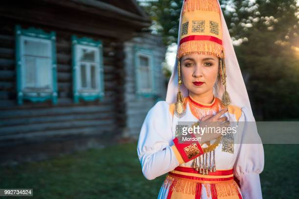 portrait of mari girl on village street - traditional clothing stock pictures, royalty-free photos & images