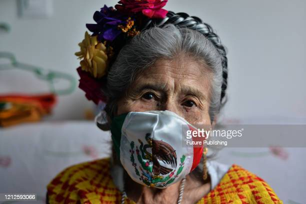 Portrait of Maria Elena Cuevas wearing a face mask with stamped Mexican flag while celebrate Mother's Day amid Coronavirus outbreak. On May 10, 2020...