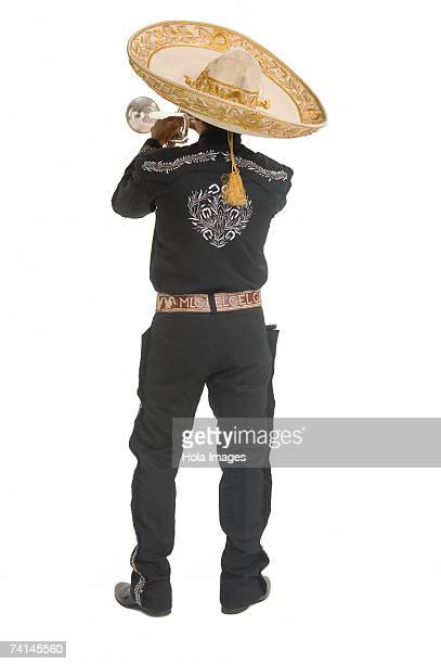 Portrait of Mariachi playing trumpet