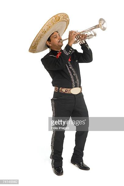 portrait of mariachi playing trumpet - mariachi stock pictures, royalty-free photos & images