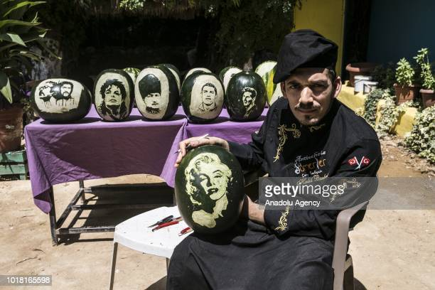 A portrait of Marilyn Monroe carved on a watermelon by cook Halil Bozkurt is seen in Turkey's Hatay on August 17 2018 Bozkurt carves portraits of...