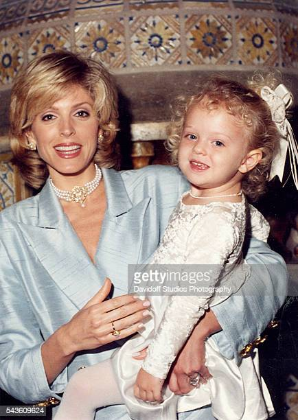 Portrait of Marla Maples as she holds her daughter Tiffany Trump at the MaraLago estate Palm Beach Florida 1996