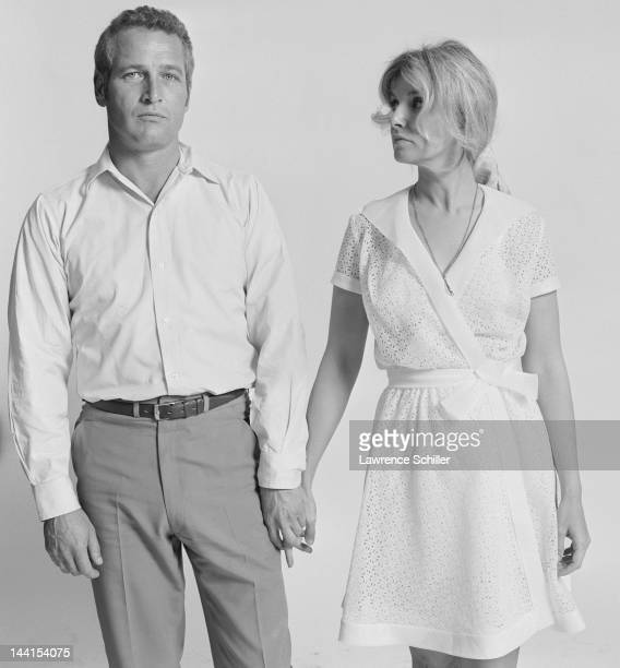 Portrait of married American actors Paul Newman and Joanne Woodward as they hold hands Los Angeles California 1967