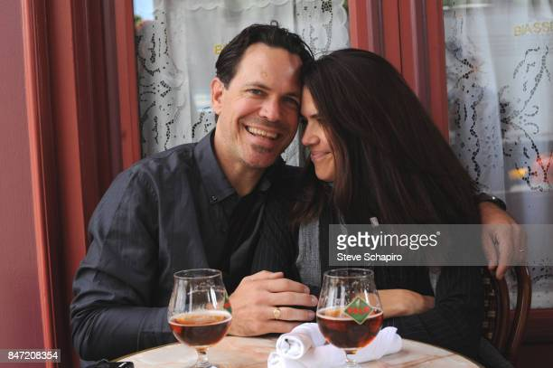 Portrait of married American couple Jazz musician Kurt Elling and dancer Jennifer Elling as they sit together at a sidewalk restaurant New York June...