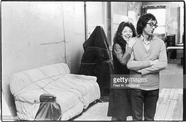Portrait of married artists Bulgarianborn Christo and French JeanneClaude as they pose in their loft apartment New York New York December 29 1976...