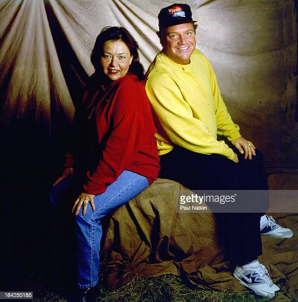 Portrait of married couple actors Roseanne Barr and Tom Arnold backstage at Farm Aid Ames Iowa March 14 1992