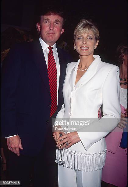 Portrait of married couple American businessman Donald Trump and Marla Maples as they pose together at Trump's 50th birthday party held at the Trump...