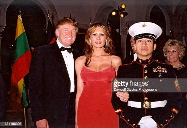 Portrait of married couple American real estate developer Donald Trump and model Melania Trump along with a US Marine color guard at the Red Cross...