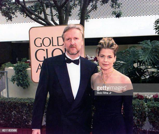 Portrait of married couple director James Cameron and actress Linda Hamilton as they pose together at the Beverly Hilton Hotel during the 55th Golden...