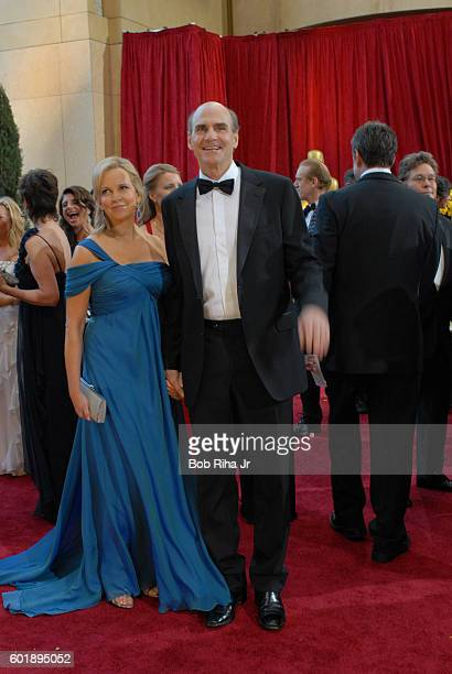 Portrait of married couple Kim Taylor and musician James Taylor as they pose together on the red carpet at the Kodak Theater during the 82nd Academy...