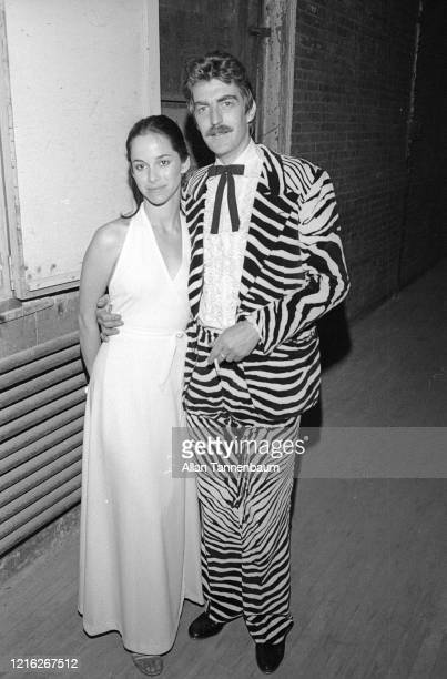 Portrait of married couple landscape designer Debra Arch Myers and artist Forrest 'Frosty' Myers, the latter in a zebra-pattern suit, as they attend...