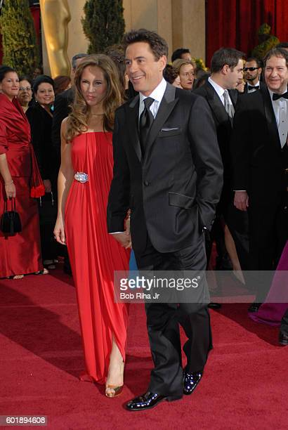 Portrait of married couple producer Susan Downey and actor Robert Downey Jr as they pose together on the red carpet at the Kodak Theater during the...