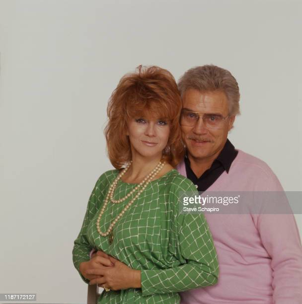 Portrait of married couple Swedishborn American actress AnnMargret and actor Roger Smith as they pose against a white background Los Angeles...