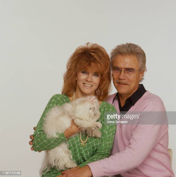 Portrait of married couple Swedishborn American actress AnnMargret and actor Roger Smith as they pose with their dog against a white background Los...