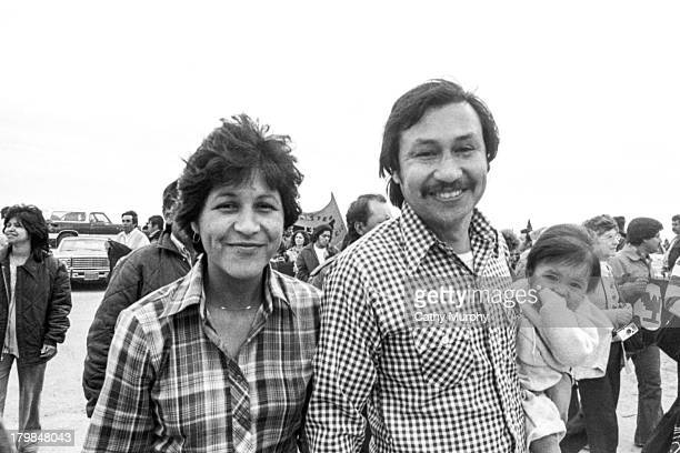 Portrait of married labor activists and United Farm Workers members Linda Chavez Rodriguez and Arturo Rodgriguez as they pose with their infant child...