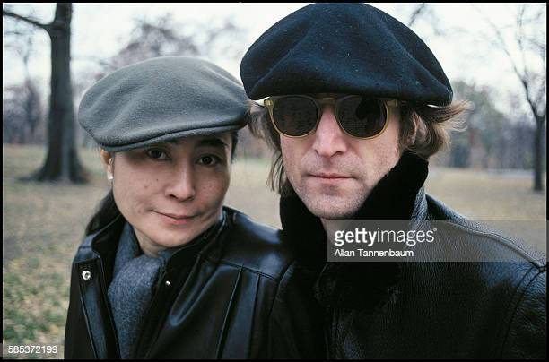 Portrait of married musicians John Lennon and Yoko Ono both in leather jackets and berets as they sit on a bench in Central Park New York New York...