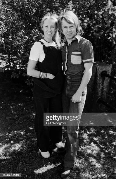 Portrait of married Swedish Pop musicians Agnetha Faltskog and Bjorn Ulvaeus both of the group ABBA as they pose in their yard Stockholm Sweden July...
