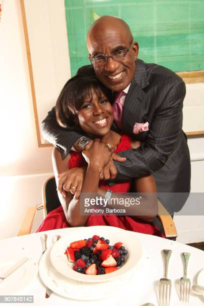 Portrait of married television journalists Deborah Roberts and Al Roker as they pose together at a breakfast table New York November 16 2010