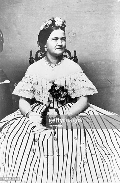 1864 Portrait of Mary Todd Lincoln in formal dress hodling a bouquet of flowers Photo by Mathew Brady Undated photo
