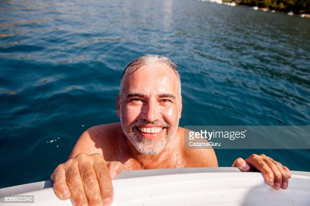 portrait of mature adult man on summer vacations - human finger stock photos and pictures