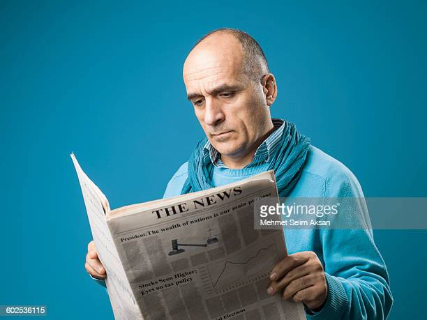 Portrait Of Mature Adult man Reading Newspaper