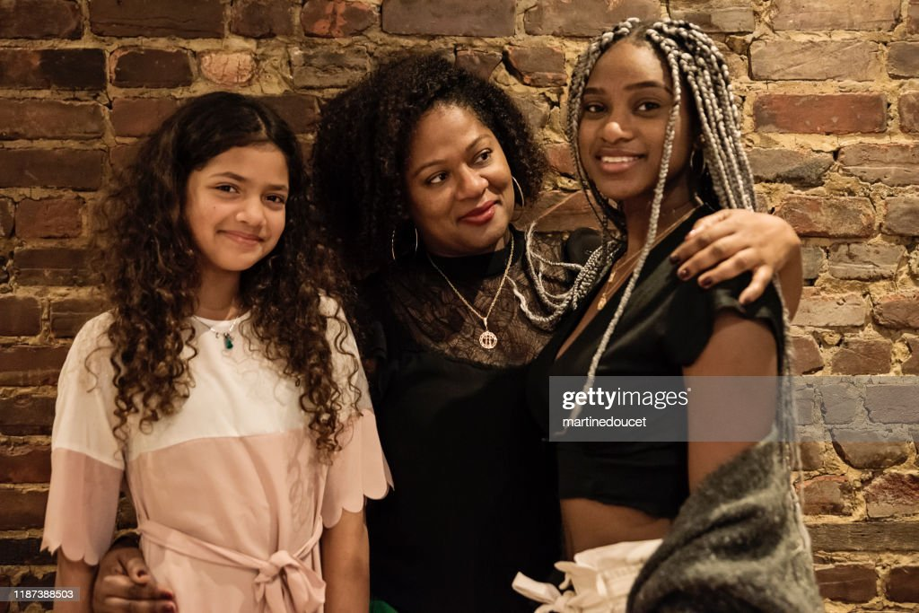 Portrait of mature African-American mother with daughters : Stock Photo
