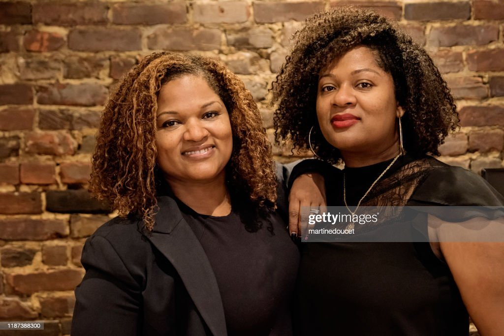 Portrait of mature African-American twin sisters : Stock Photo