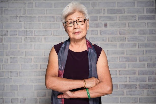 portrait of mature asian woman. - old asian woman stock pictures, royalty-free photos & images