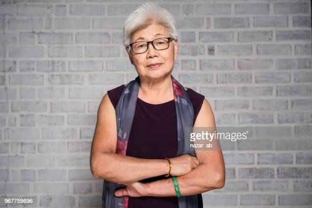 portrait of mature asian woman. - malaysian culture stock pictures, royalty-free photos & images