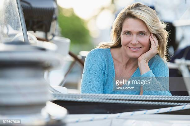 portrait of mature attractive woman on sailboat - hand on chin stock pictures, royalty-free photos & images