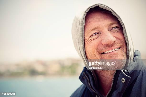 Portrait of mature Australian man in hood