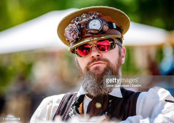 portrait of mature bearded man wearing sunglasses and cap - steve guessoum stockfoto's en -beelden