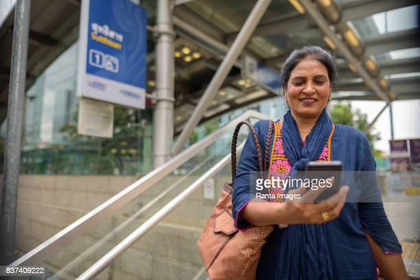 Portrait of mature beautiful Indian woman outside the MRT subway train station in Bangkok Thailand