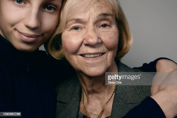 Portrait of mature blonde woman with her grandson