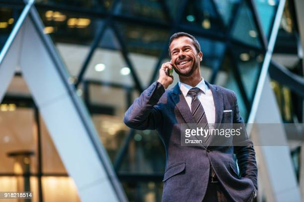 portrait of mature business person with mobile phone - high society stock pictures, royalty-free photos & images
