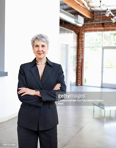 """portrait of mature business woman in a suit - """"compassionate eye"""" stock pictures, royalty-free photos & images"""